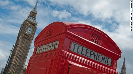 A traditional red telephone box sits beside Big Ben and The Houses of Parliament in Parliament Square in London on August 4, 2012, during London 2012 Olympic Games. AFP PHOTO / WILL OLIVER        (Photo credit should read WILL OLIVER/AFP/Getty Images)