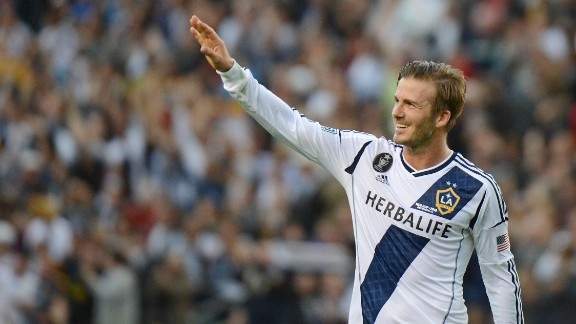 (FILES) Picture taken on December 1, 2012 of David Beckham saluting the fans after the Los Angeles Galaxy beat Houston Dynamo 3-1 in the Major League Soccer (MLS) Cup in Carson,.California. According to news reports on January 31, 2013 David Beckham is set to join French club Paris Saint-Germain.   AFP PHOTO / Robyn Beck        (Photo credit should read ROBYN BECK/AFP/Getty Images)