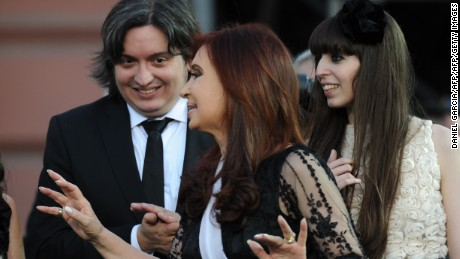 Argentina's reelected President Cristina Fernandez de Kirchner (C) gestures next to her daughter Florencia and her son Maximo during her inauguration ceremony, in Mayo square, Buenos Aires on December 10, 2011. President Cristina Kirchner was sworn in Saturday to a second four-year term at the peak of her popularity but with the country's booming economy shadowed by Europe's financial crisis. AFP PHOTO / DANIEL GARCIA (Photo credit should read DANIEL GARCIA/AFP/Getty Images)