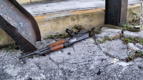 A Kalashnikov assault rifle found in the site where a shooting erupted ensuing an attack against the building of the Quintana Roo State Prosecution, in Cancun, Mexico, on January 17, 2017.  The shooting happened as Mexican authorities investigate whether a feud over local drug sales was behind a nightclub shooting that killed three foreigners and two Mexicans Monday at the Blue Parrot club during the BPM electronic music festival in Playa del Carmen, a usually peaceful Caribbean seaside town. / AFP / STR        (Photo credit should read STR/AFP/Getty Images)