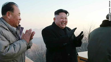 North Korean leader Kim Jong Un applauds Monday's ballistic missile launch.