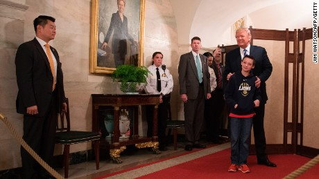 President Donald Trump stands with 10-year-old Jack Cornish of Birmingham, Alabama, as he surprises visitors during the official reopening of public tours at the White House on March 7, 2017.