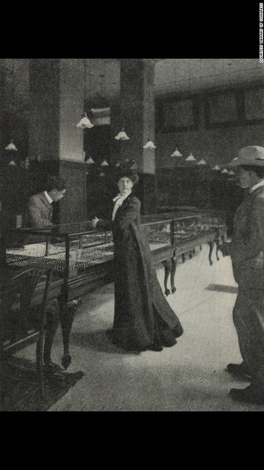This photo illustration, showing a woman and two men in a jewelry store, was for an article in 1902. Ben-Yusuf, the London-born daughter of a German mother and Algerian father, came to the United States in 1895. Later in life, she transitioned from photography into the world of fashion.
