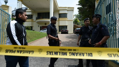 Royal Malaysia Police guard the entrance to the North Korean Embassy in Kuala Lumpur on Tuesday.