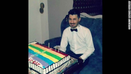 Zigorat on his birthday with a rainbow flag cake.