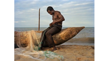 Fisherman Peter Chirwa, 45, prepares his nets in Ngosi Village, Malawi