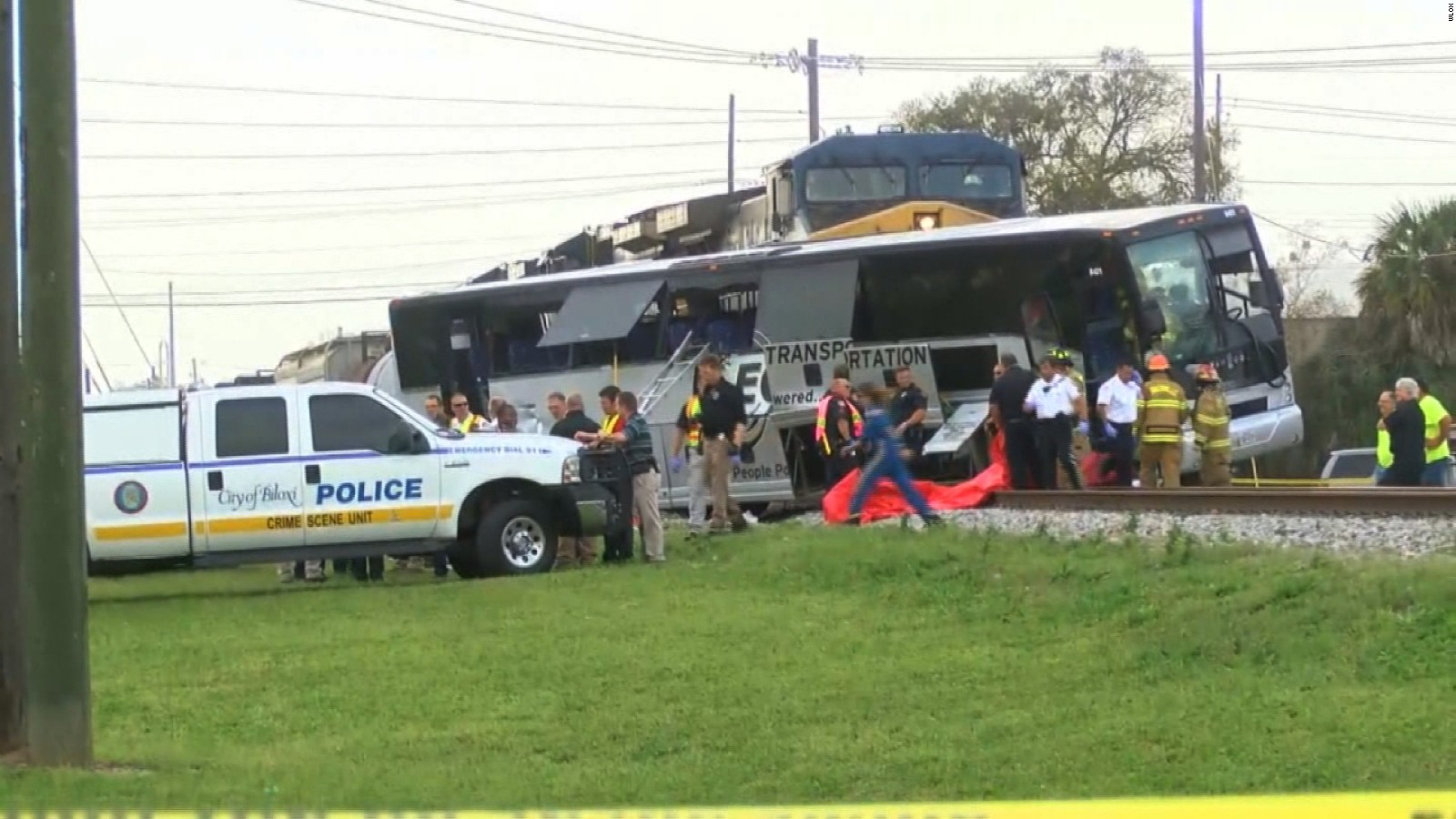 At least 4 dead after freight train hits bus