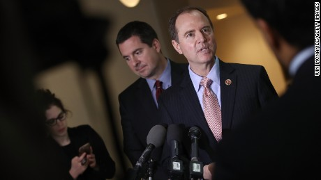 Rep. Adam Schiff, at right and then-ranking Democratic member of the House Intelligence Committee, and Devin Nunes, at left, the then-Intelligence chairman, answer questions at the US Capitol during a press conference in March 2017.  (Photo by Win McNamee/Getty Images)