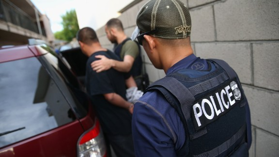 LOS ANGELES, CA - OCTOBER 14:  A man is detained by U.S. Immigration and Customs Enforcement (ICE), agents on October 14, 2015 in Los Angeles, California. ICE agents said the immigrant, holding a Green Card, was a convicted criminal and member of the Alabama Street Gang. ICE builds deportation cases against thousands of immigrants living in the United States. Green Card holders are also vulnerable to deportation if convicted of certain crimes. The number of ICE detentions and deportations from California has dropped since the state passed the Trust Act in October 2013, which set limits on California state law enforcement cooperation with federal immigration authorities.  (Photo by John Moore/Getty Images)