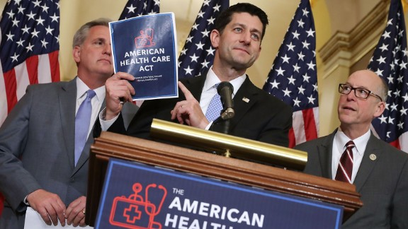 Speaker of the House Paul Ryan (R-WI) (C) holds up a copy of the American Health Care Act during a news conference with House Majority Leader Kevin McCarthy (R-CA) (L) and House Energy and Commerce Committee Chairman Greg Walden (R-OR) outside Ryan