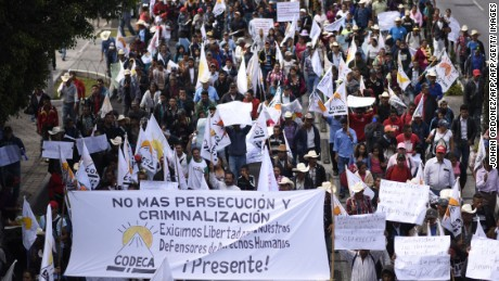 "Members of the Peasant Development Committee (CODECA) march to demand the resignation of Guatemalan President Jimmy Morales for ""his inability to govern"" and possible acts of corruption in his government, in Guatemala City on March 7, 2017. / AFP PHOTO / Johan ORDONEZ        (Photo credit should read JOHAN ORDONEZ/AFP/Getty Images)"