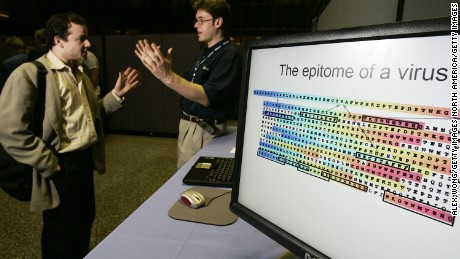 "WASHINGTON - APRIL 27:  Researcher Nebojsa Jojic (R) of Microsoft Research talks to physicist Steve Sax (L) of the U.S. Patent and Trademark Office as he demonstrates ""Biology and Machine Learning"" during a Microsoft Tech Fair April 27, 2005 at the Library of Congress in Washington, DC. Researchers have discovered that some of the pattern recognition, data mining and visualization techniques that have been successful in automatic analysis of other types of data, such as photographs or spam e-mails, are also well suited to deriving new biological insights and medical treatments. Such techniques are already helping to advance HIV vaccine research.  (Photo by Alex Wong/Getty Images)"