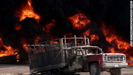 View of a burnt truck following the explosion of a petrol pipeline caused by fuel theft, in Acatzingo, Puebla State, on March 7, 2017.  / AFP PHOTO / JOSE CASTAÑARES        (Photo credit should read JOSE CASTANARES/AFP/Getty Images)