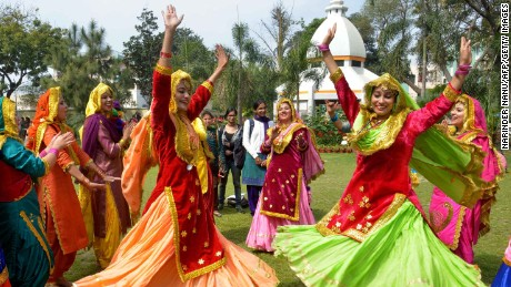 Young Indian women perform the 'Giddha' dance during Women's Day celebrations in Amritsar.