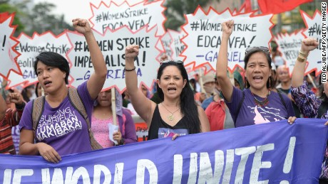 Members of women's group Gabriela march in Manila.