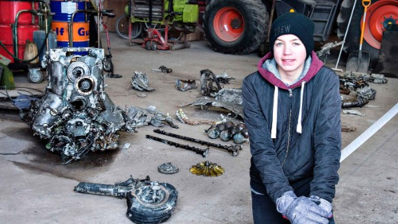 14-year-old Danish boy Daniel Rom Kristensen is photographed on March 7, 2017 in front of debris from the wreck of a World War II aircraft, which Daniel and his father Klaus Kristensen found yesterday near Birkelse by Aabybro, in Northern Jutland.  In the wreck there was also the body of the plane's pilot and some ammunition. The plane is a German fighter plane type ME 109 Messerschmidt from World War II. Daniel and Klaus Kristensen found the wreck with a metal dectector in a bog.  / AFP PHOTO / Scanpix Denmark / Henning Bagger / Denmark OUT        (Photo credit should read HENNING BAGGER/AFP/Getty Images)