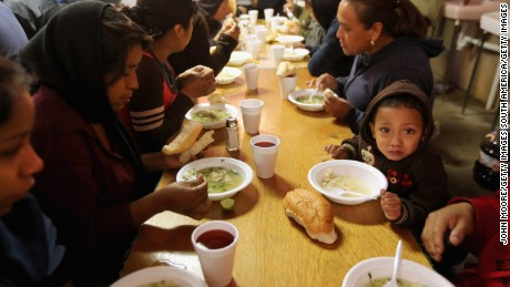 NOGALES, MEXICO - MARCH 10:  Immigrants and their families eat at the Kino Initiative center near the Mariposa border crossing between Mexico and the United States on March 10, 2013 in Nogales, Mexico. The soup kitchen often feeds hundreds of immigrants daily, including those recently deported from the U.S. and those about to try and cross into the United States illegally.  (Photo by John Moore/Getty Images)