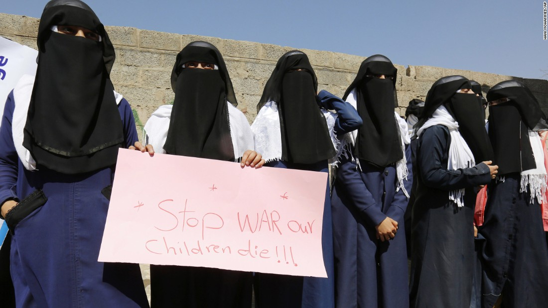 Women hold a banner as they protest in front of the United Nations building in Sanaa, Yemen.