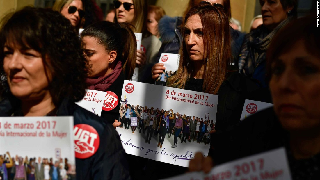 Trade union members show solidarity for female workers outside the union headquarters in Pamplona, Spain.