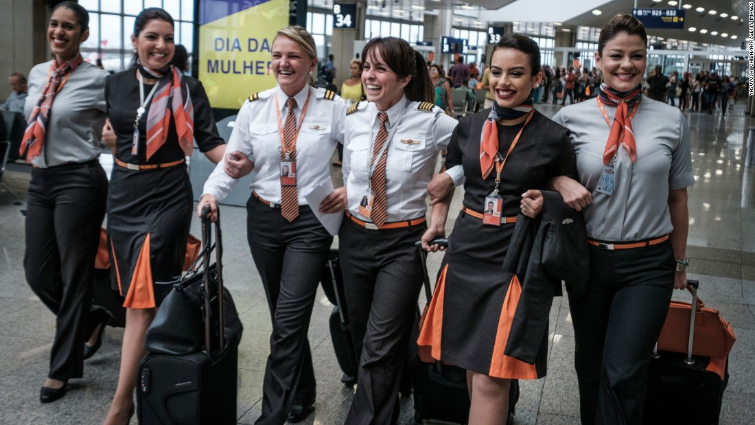 Brazilian airline pilot Gabriela Carneiro Duarte, third from right, walks with her all-female crew before departing for a flight in Rio de Janeiro.