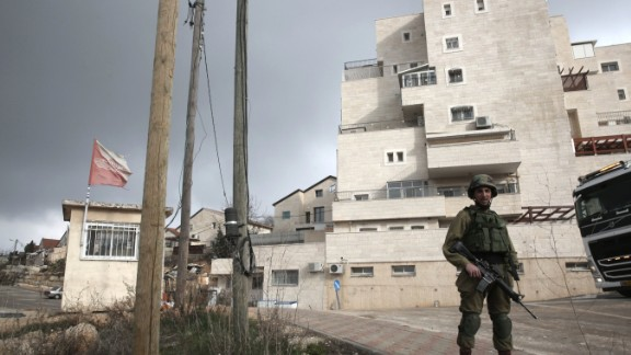 This photo taken on January 25, 2017 shows an Israeli soldier (R) standing guard in the Israeli settlement of Beit El near the West Bank city of Ramallah. Israel has moved immediately to take advantage of US President Donald Trump