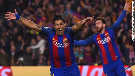 TOPSHOT - Barcelona's Uruguayan forward Luis Suarez (L) celebrates after scoring the opener during the UEFA Champions League round of 16 second leg football match FC Barcelona vs Paris Saint-Germain FC at the Camp Nou stadium in Barcelona on March 8, 2017. / AFP PHOTO / JOSEP LAGO        (Photo credit should read JOSEP LAGO/AFP/Getty Images)