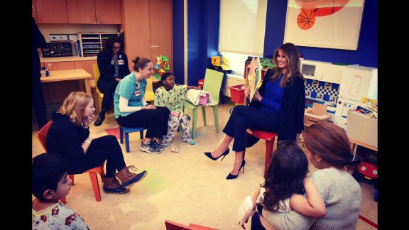 "The first lady's Twitter account posted this photo of Trump reading a book to children at New York-Presbyterian Hospital. ""Honoring children #worldbookday,"" the tweet said in March 2017."