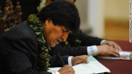Bolivian President Evo Morales promulgates a government bill increasing the legal areas of cultivation of coca, during a ceremony at the Quemado presidential palace in La Paz, on March 8, 2017. Under the new law, the legal cultivation area for the country's two main coca-growing regions would be extended from 12,000 hectares to 22,000 -- capped at 14,300 hectares for the Los Yungas region and 7,700 hectares in the Chapare region, where Morales used to grow coca. / AFP PHOTO / JORGE BERNAL        (Photo credit should read JORGE BERNAL/AFP/Getty Images)