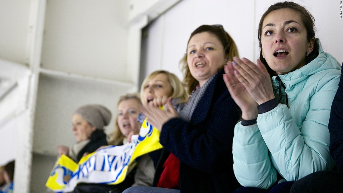 Fans cheer at the Ice Arena in Kiev.