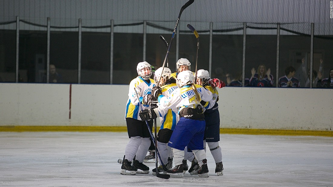 The tournament also hoped to transcend the economic and political turmoil afflicting Ukraine with the war going on in the east of the country. Here, Kyiv Ukrainochka players celebrate a goal.