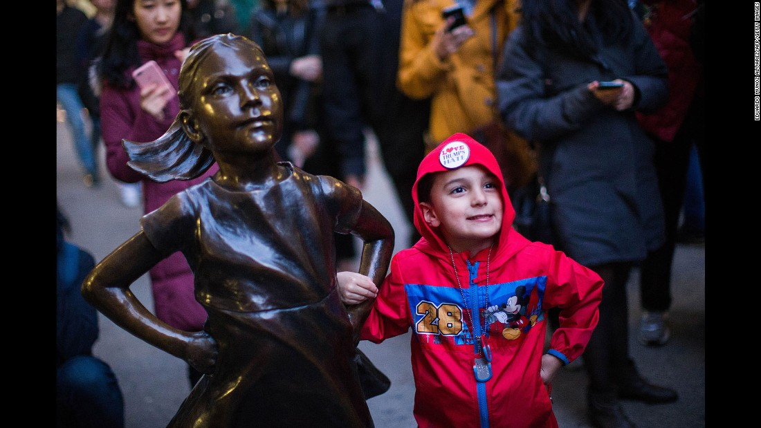 "Kenny Simmers, 4, of New Jersey strikes a pose with the ""Fearless Girl."""