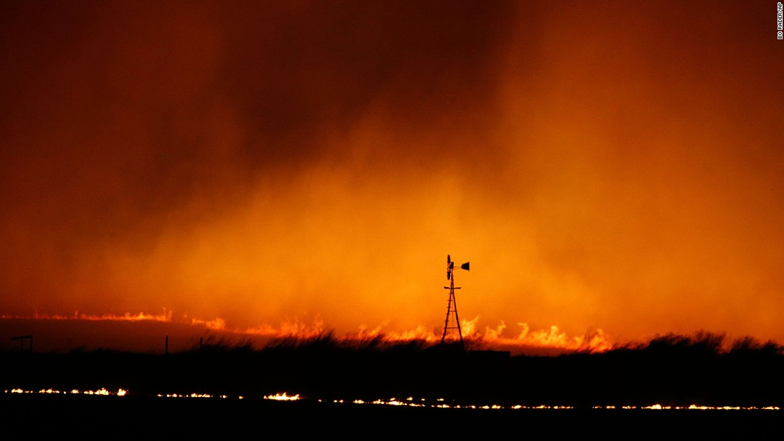 "A wildfire burns near a windmill north of Protection, Kansas, on Tuesday, March 7. Wildfires across the country <a href=""http://www.cnn.com/2017/03/07/us/wildfires-texas-deaths/"" target=""_blank"">had consumed more than 1 million acres</a> by Tuesday night, taking at least seven lives. Other states affected were Colorado, Florida, Oklahoma and Texas."