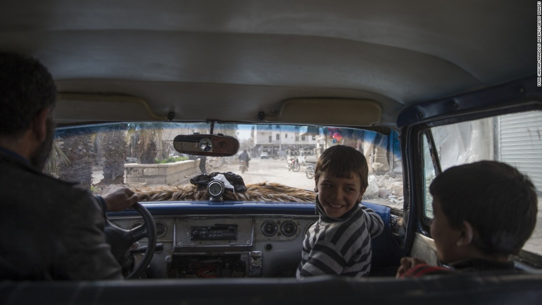 People drive in Aleppo, Syria, on Sunday, March 5. The city has been wracked by violence during the country's five-year civil war.