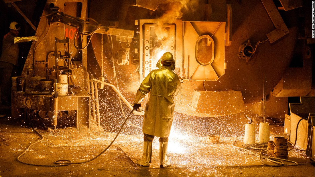 A worker cleans a melting pot at a steel mill in Salzgitter, Germany, on Tuesday, March 7.