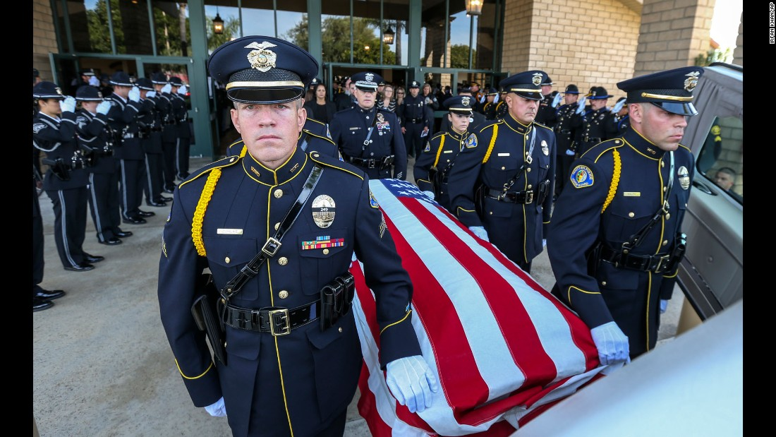 "Police officers from Whittier, California, attend the funeral procession of slain officer Keith Boyer on Friday, March 3. Boyer, a 27-year veteran of the Whittier Police Department, <a href=""http://www.cnn.com/2017/02/20/us/slain-california-officer/"" target=""_blank"">was killed in February</a> by a recently paroled gang member, authorities said."