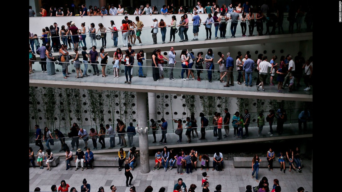 People in Santiago, Chile, line up to enter a Pablo Picasso exhibition at the Palacio La Moneda Cultural Center on Sunday, March 5.