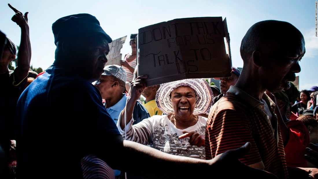 People from the Reiger Park township protest service and housing issues in Boksburg, South Africa, on Thursday, March 9.