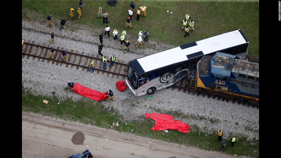 "First responders work at the scene where a train hit a bus in Biloxi, Mississippi, on Tuesday, March 7. Officials believe the bus became stuck on the elevated crossing before <a href=""http://www.cnn.com/2017/03/08/us/biloxi-mississippi-bus-train-crash-site-history/index.html"" target=""_blank"">the train hit,</a> killing four and injuring dozens, a police spokeswoman said."