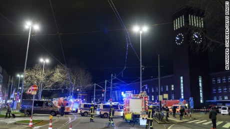Police and emergency workers stand outside the main railway station Thursday following what police described as an ax attack in Dusseldorf, Germany.