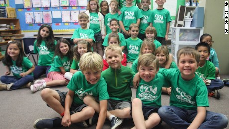 Ryan and his classmates with Ryan's Recycling Company T-shirts.