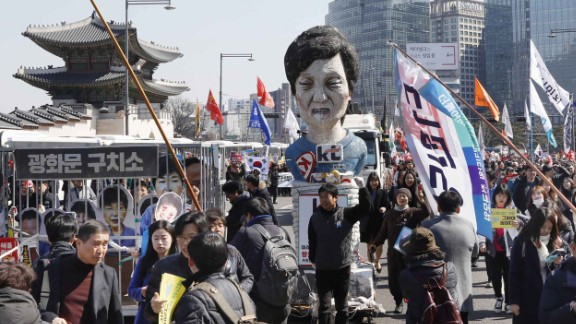 An effigy of Park is paraded through the streets of Seoul.