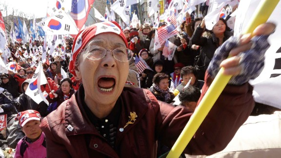 A supporter of South Korean President Park Geun-hye cries during a rally opposing her impeachment.