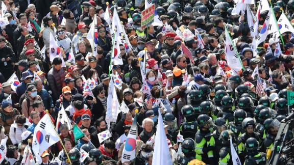 Police block Park supporters as they march toward the Constitutional Court in opposition of her impeachment.