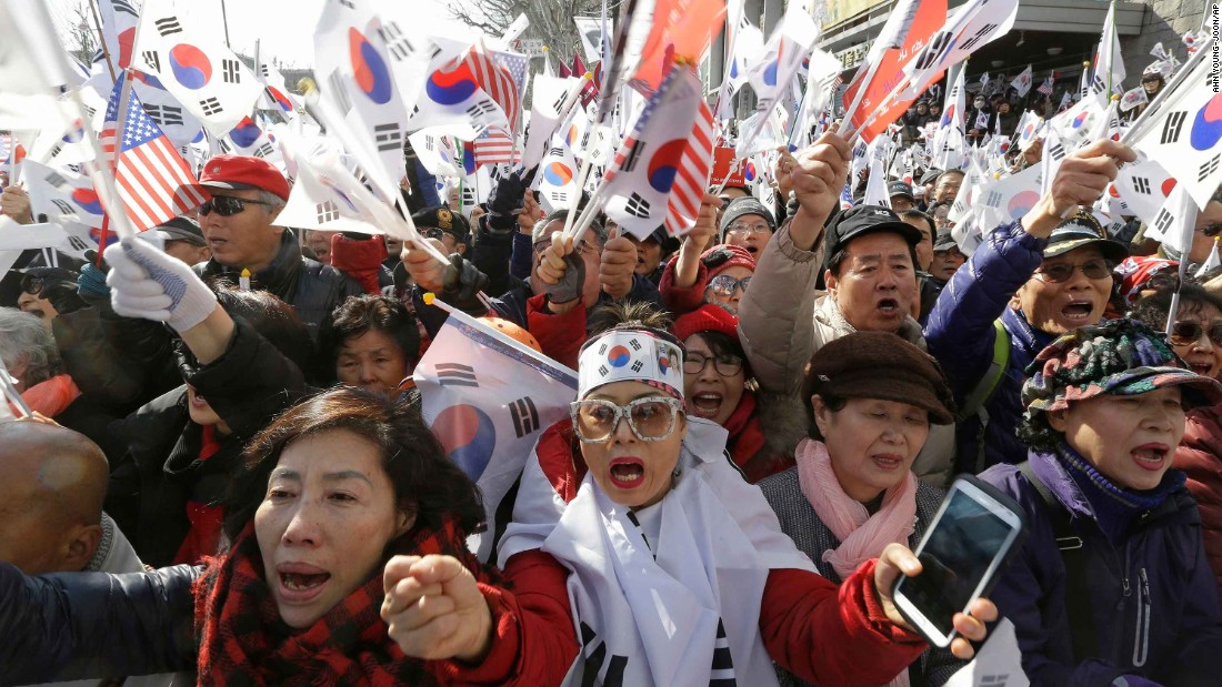Park supporters shout slogans and wave South Korean flags during a rally to oppose her impeachment.