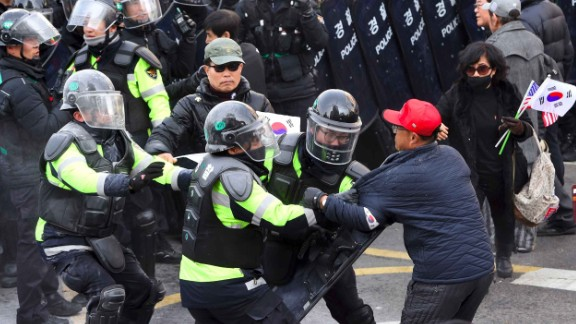 Park supporters clash with police after the country's Constitutional Court announced it would uphold her impeachment.