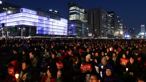 South Koreans celebrate in Seoul after the Constitutional Court upheld a parliamentary vote to impeach President Park Geun-hye on Friday, March 10. Demonstrators both for and against Park took to the streets after the verdict.