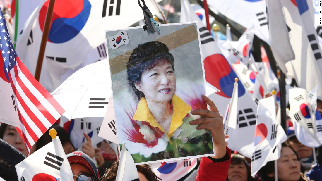 A Park supporter holds up her portrait during a March rally opposing her impeachment.