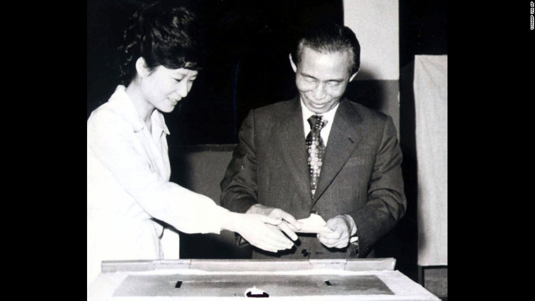 "Park casts a ballot with her father, who was assassinated by his own security chief in 1979. After the loss of her father, Park withdrew from the public sphere, living what she described as ""a very normal life."""