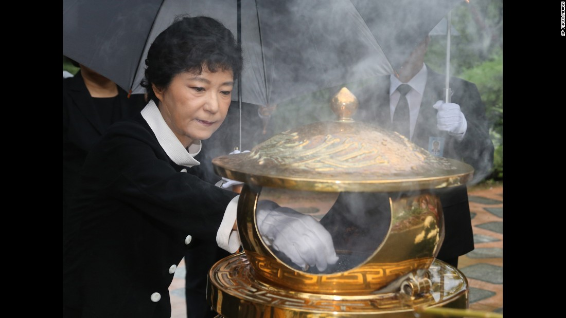 Park burns incense at the tomb of her father in August 2012, soon after she was named the presidential candidate for the ruling Saenuri Party.