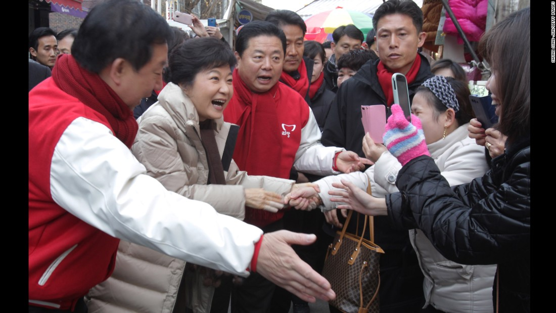 Park greets people in downtown Seoul during the launch of her presidential campaign in November 2012.